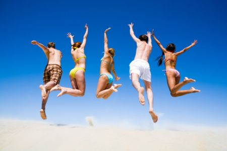 Group of Energetic People at the Beach
