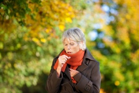 Woman Coughing Due to Illness
